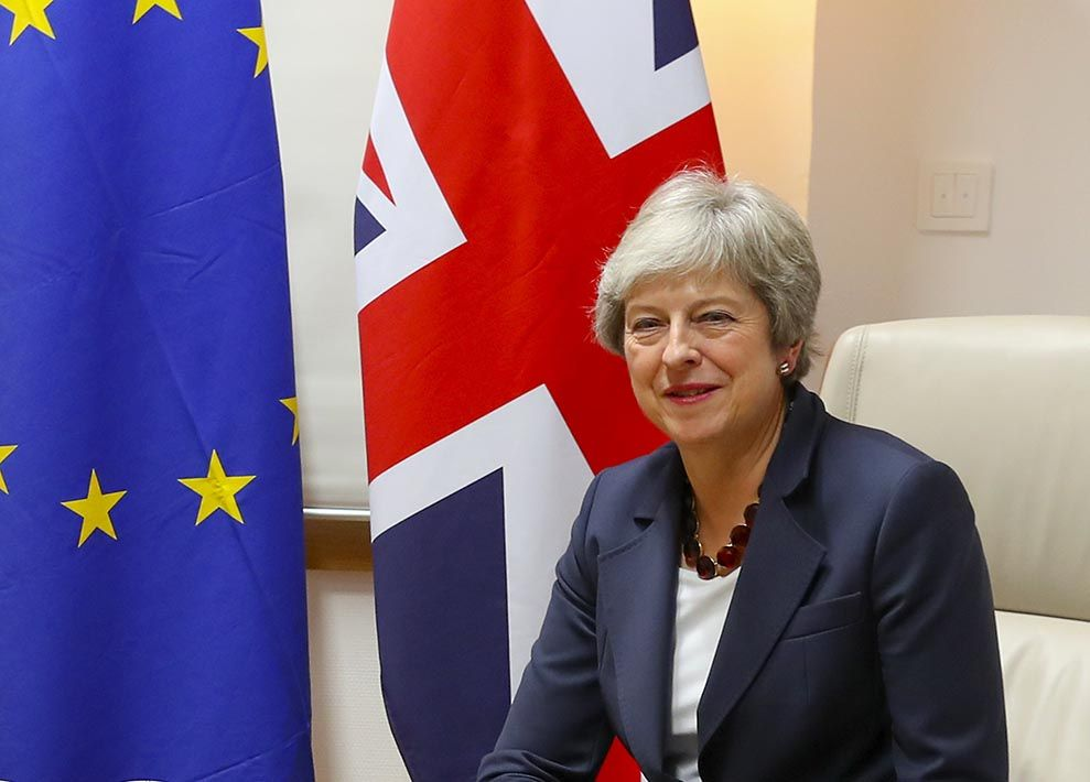 May in front of flags